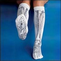 Illustrative onesize skeletsokker med zoneterapi-punkter i fodsålen