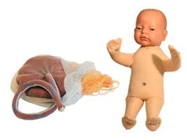 Fosterdukke med placenta og navlestreng samt synlig chorion og amnion